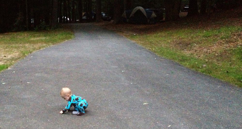 baby in pajamas at campsite