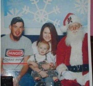 man wearing inappropriate shirt in family christmas shot