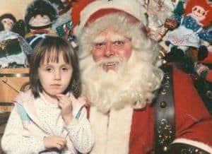 weird santa photo with little girl and creepy santa