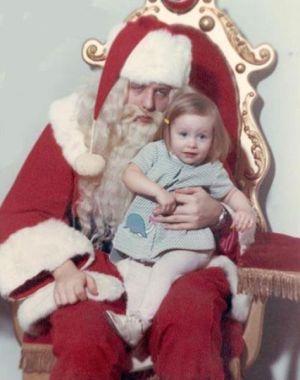 sleepy santa with little girl in vintage santa picture