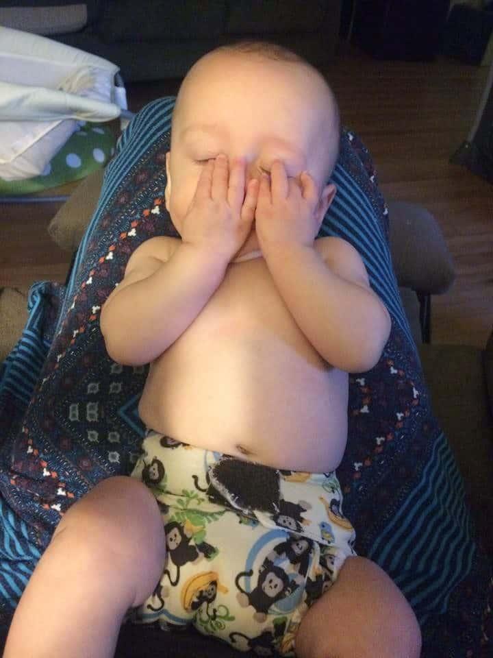 sleepy baby wearing cloth diaper