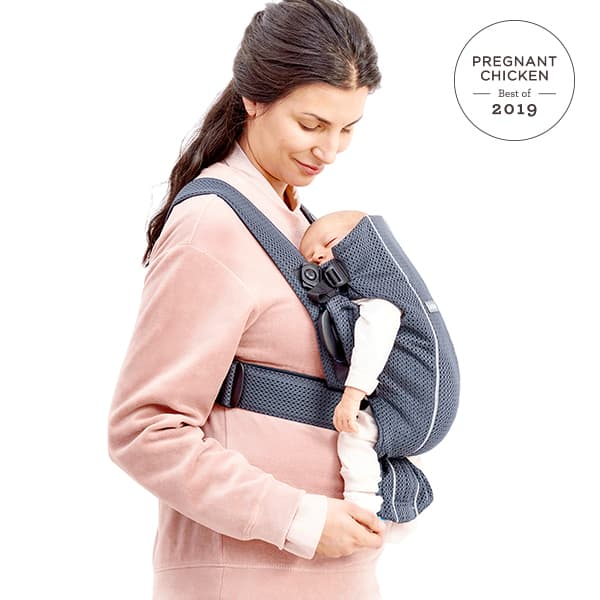 woman wearing baby bjorn baby carrier mini - best baby products 2019