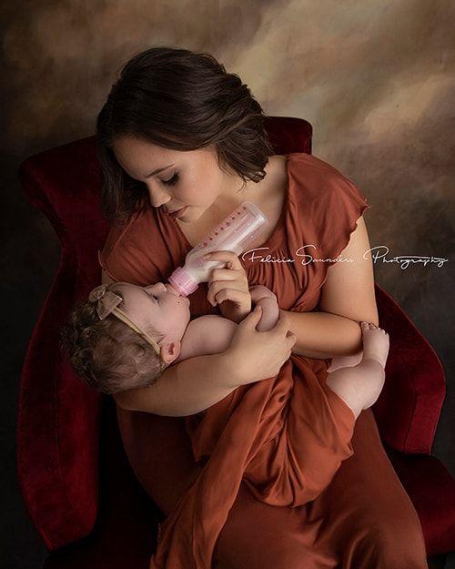 mother bottle feeding her baby formula