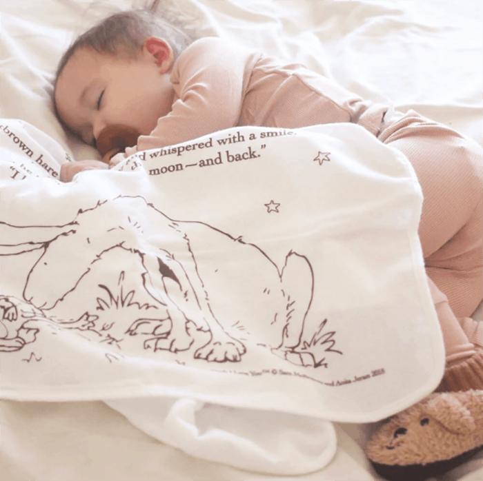 baby sleeping with storybook blanket