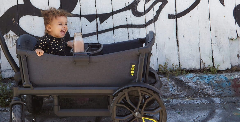 baby sitting in veer cruiser stroller wagon