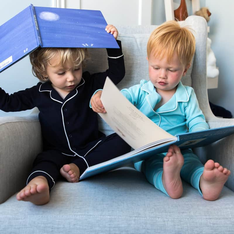 toddlers reading books from subscription service