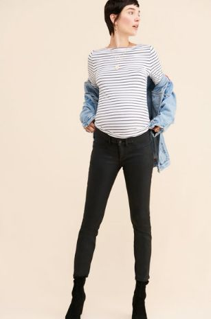 pregnant woman dressed in striped shirt and black jeans with denim jacket after she shopped at Nuuly to rent maternity clothes