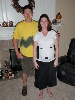 Husband dressed as Charlie Brown with pregnant Snoopy wife