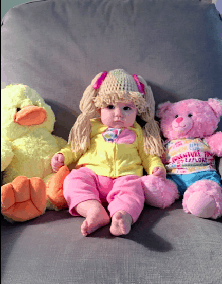 Cabbage patch kid with toys