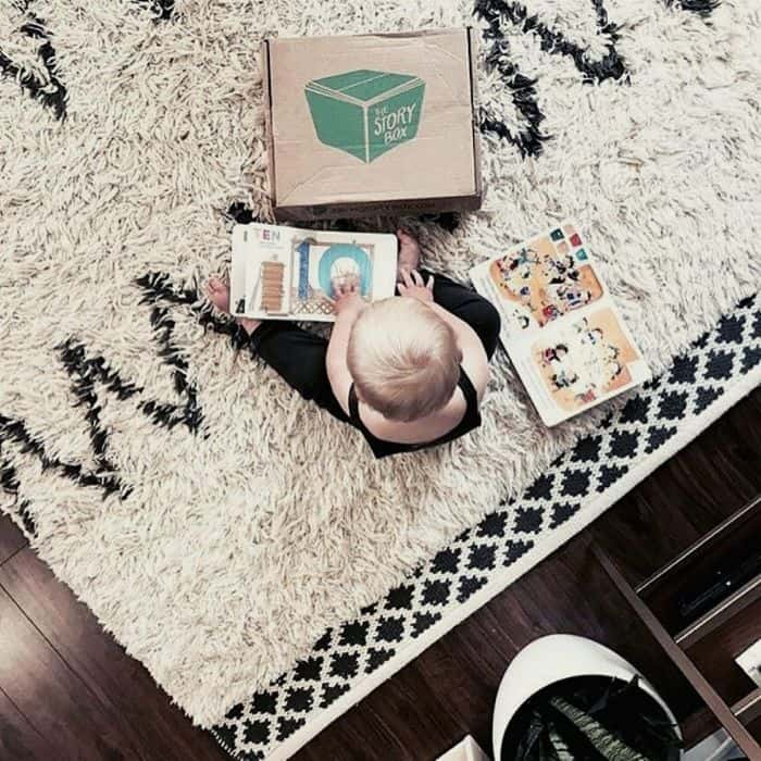 baby reading book from baby subscription box