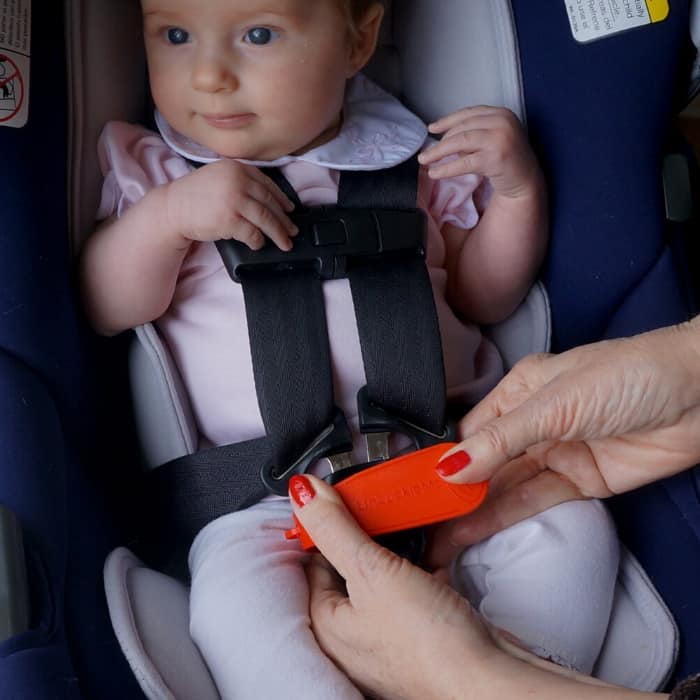 baby in a car seat with unbuckle me