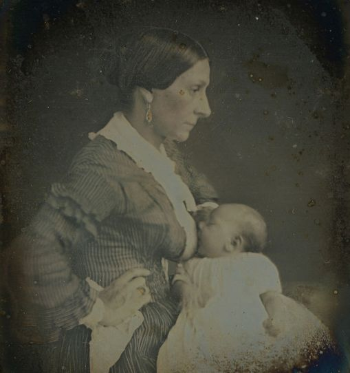 Black and white photo with profile of mother breastfeeding baby