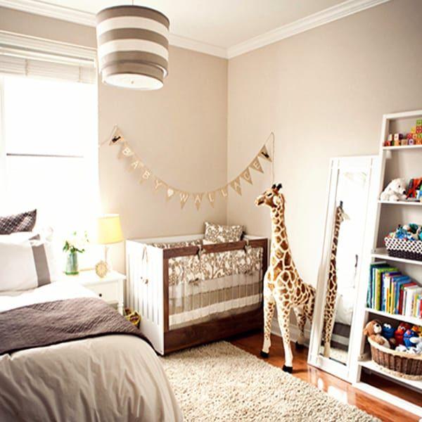 giraffe themed nursery nook tucked into corner of master bedroomgiraffe themed nursery nook tucked into corner of master bedroom