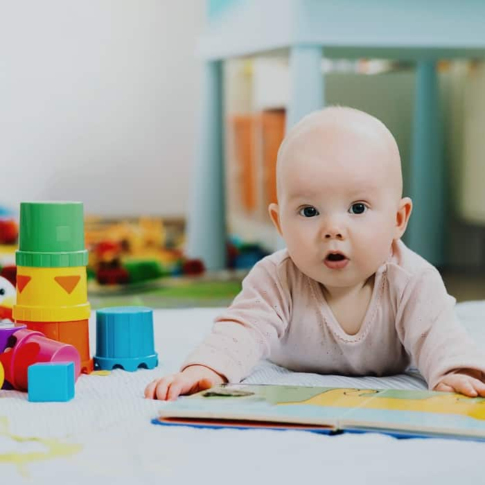 baby with book during tummy time
