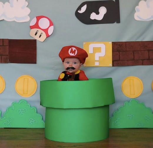 baby dressed as Mario video game
