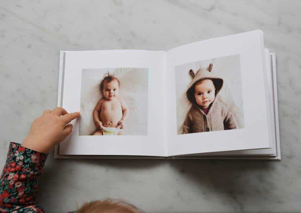 custom photo book showing two babies