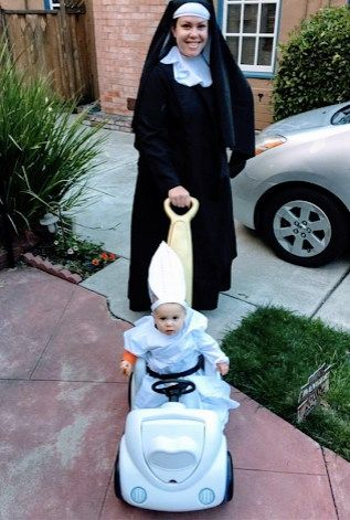 mom dressed as nun with baby dressed as pope