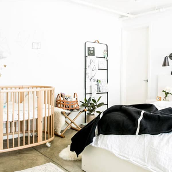 white room with crib and bedwhite room with bed and crib