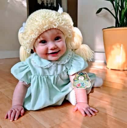 baby dressed as cabbage patch doll