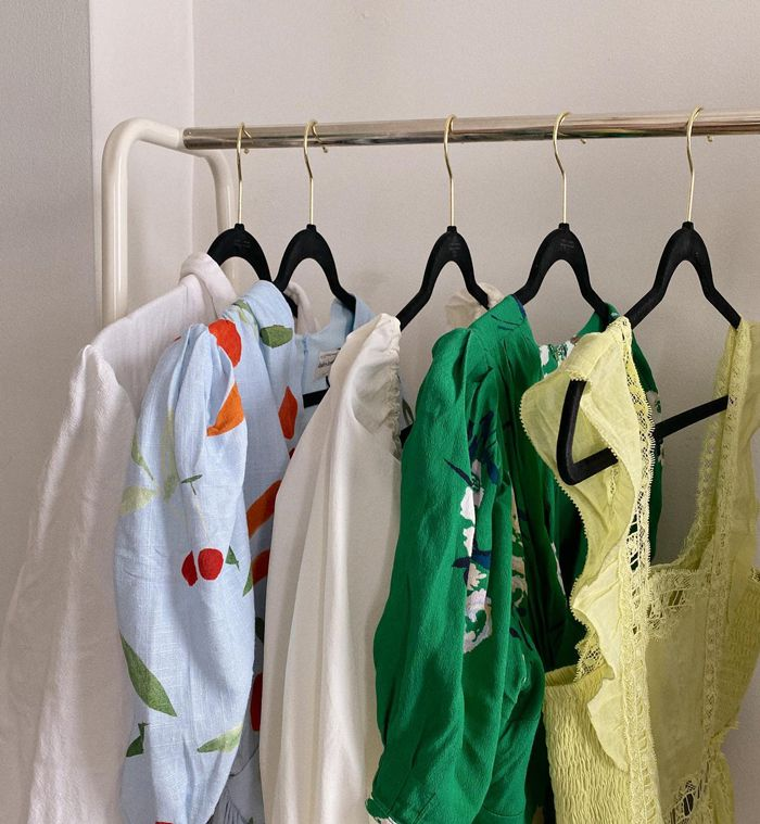 rented clothes from Nuuly on a rack