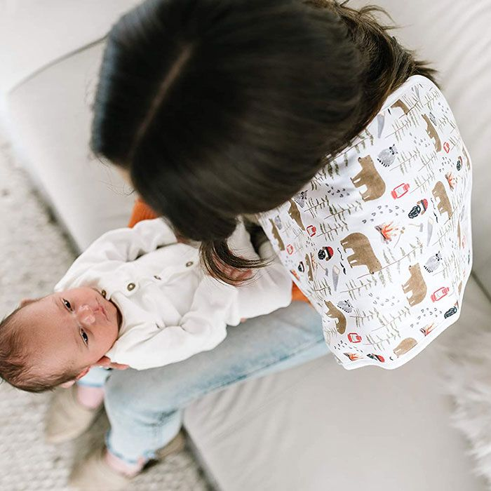"""mom holding newborn with """"Lumberjack"""" burp cloth by Copper Pearl"""