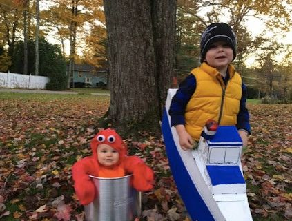 baby dressed as lobster with older brother as boat captain