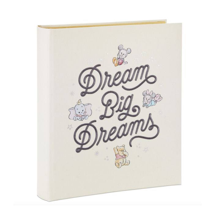 """Ivory baby book cover with text, """"Dream Big Dreams"""", and four classic Disney characters: Mickey and Minnie, Dumbo and Winnie the Pooh"""