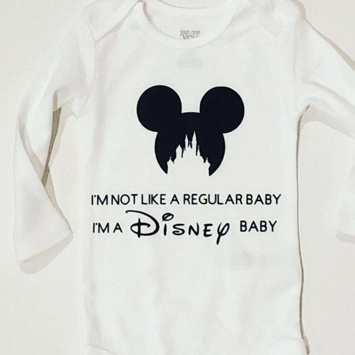 "White onesie that says ""I'm not like a regular baby I'm a Disney baby"""