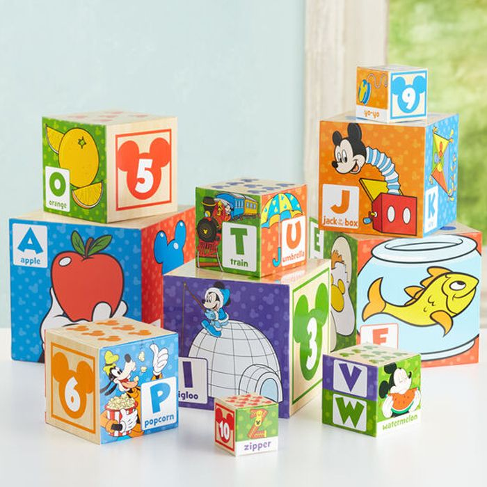 Collection of colorful cardboard stacking blocks featuring Disney characters, numbers, and letters.