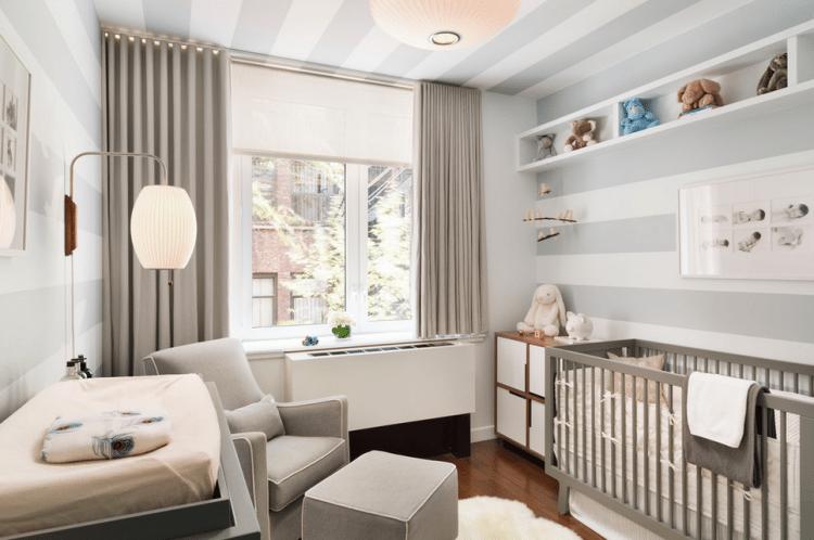 nursery with blackout curtains to help sleep train baby