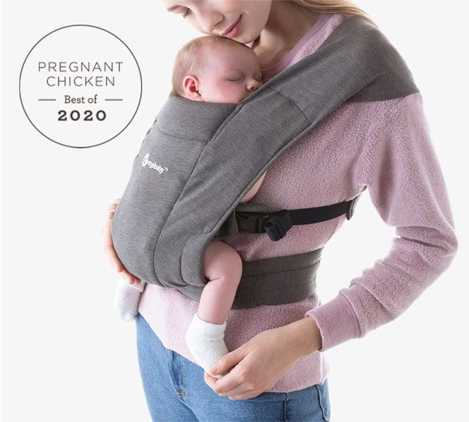 mom holding newborn baby in an Ergobaby Embrace