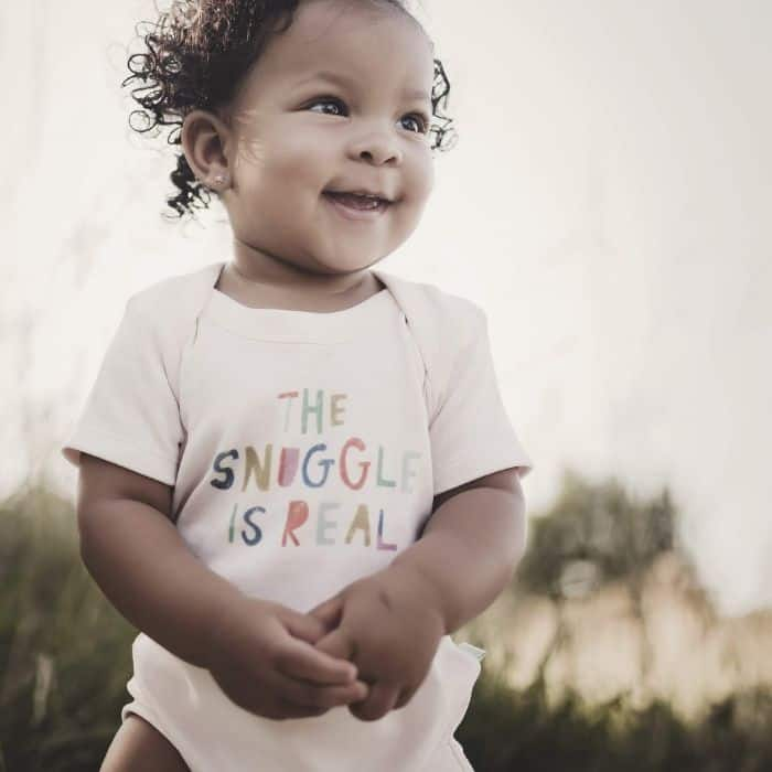 toddler wearing a 'the snuggle is real' onesie