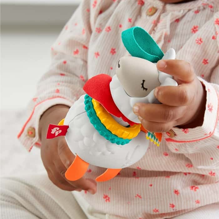 baby playing with Fisher Price Click Clack llama