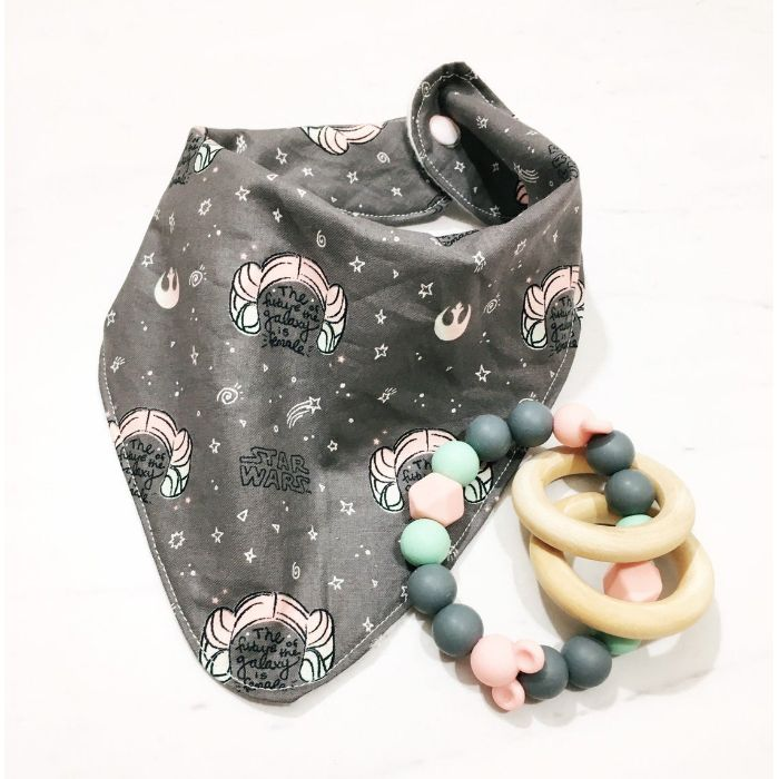 """Gray and pink Star Wars themed drool bib with """"the future of the galaxy is female"""" written in script"""