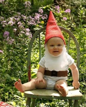 baby outside dressed as gnome