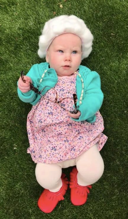 baby dressed up as little old lady