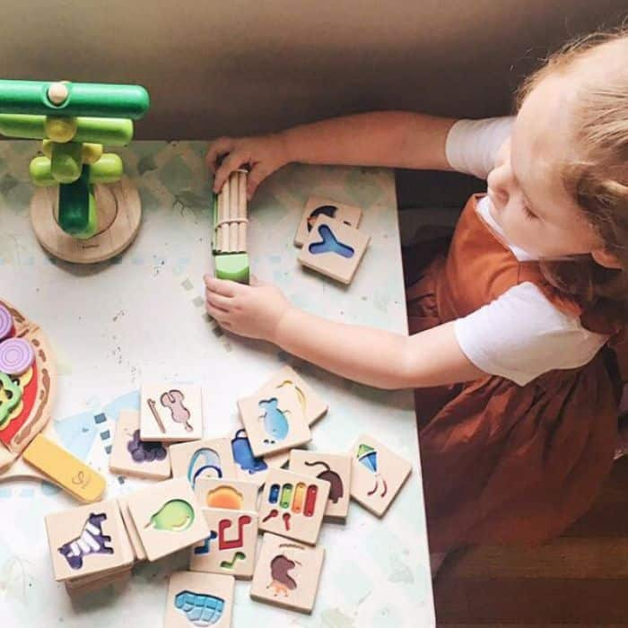 Child playing with toys from Green Piñata toy subscription box