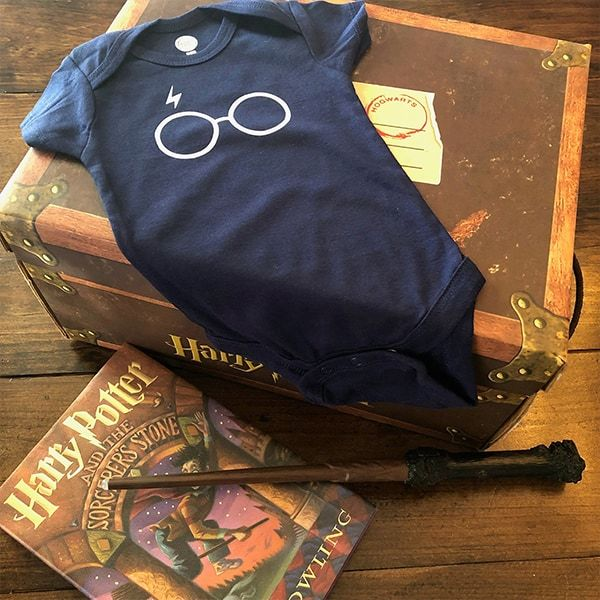 dark navy onesie with Harry Potter lightening bolt and glasses graphic