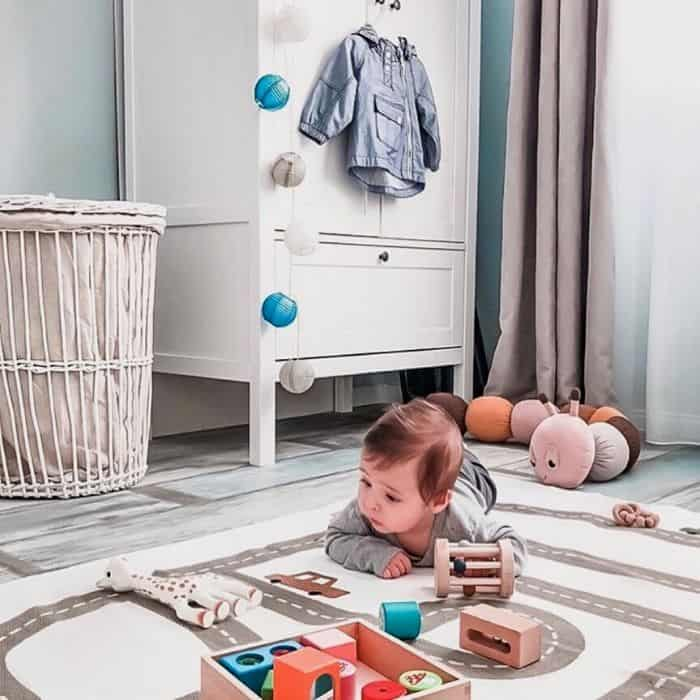 baby playing on the floor with toys from baby subscription box