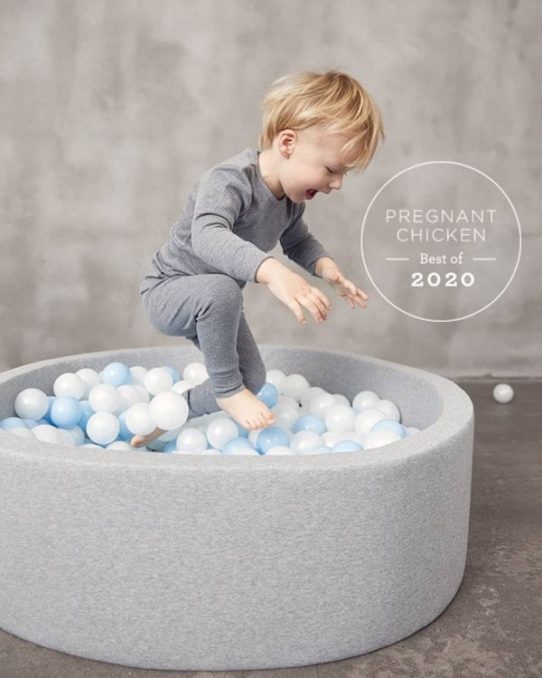 toddler jumping in gray Kidkii Ball Pit