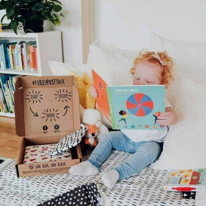 Kid reading book from baby subscription box