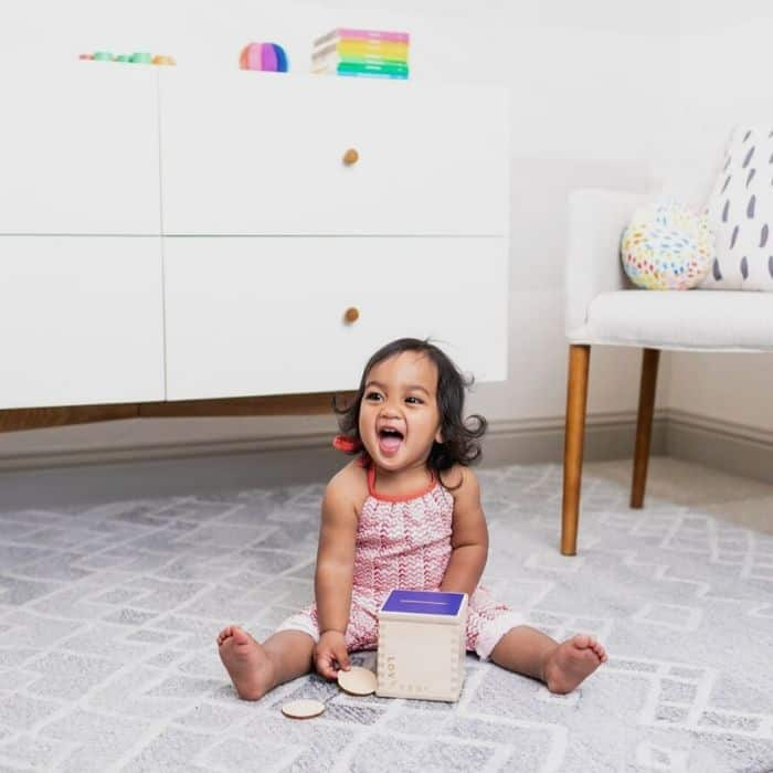 toddler playing with toy from baby subscription box