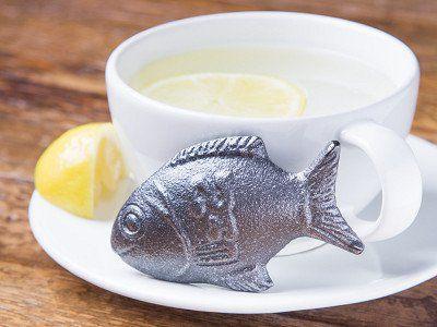 lucky iron fish next to lemon and mug