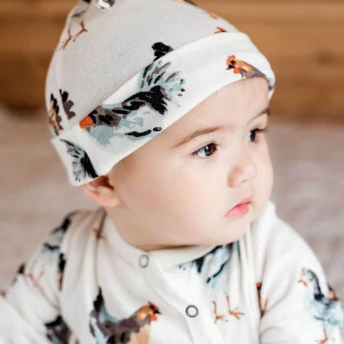 close up of baby wearing Milk Barn Kids