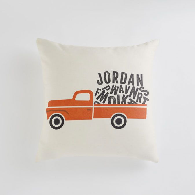 custom name pillow with a red truck as a unique gift for a newborn