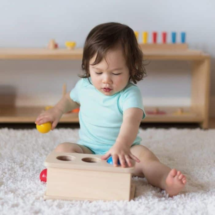 Baby playing with toy from baby subscription box