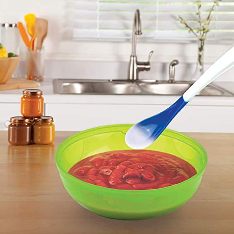 heat detecting baby spoon stirring bowl of pureed red fruit