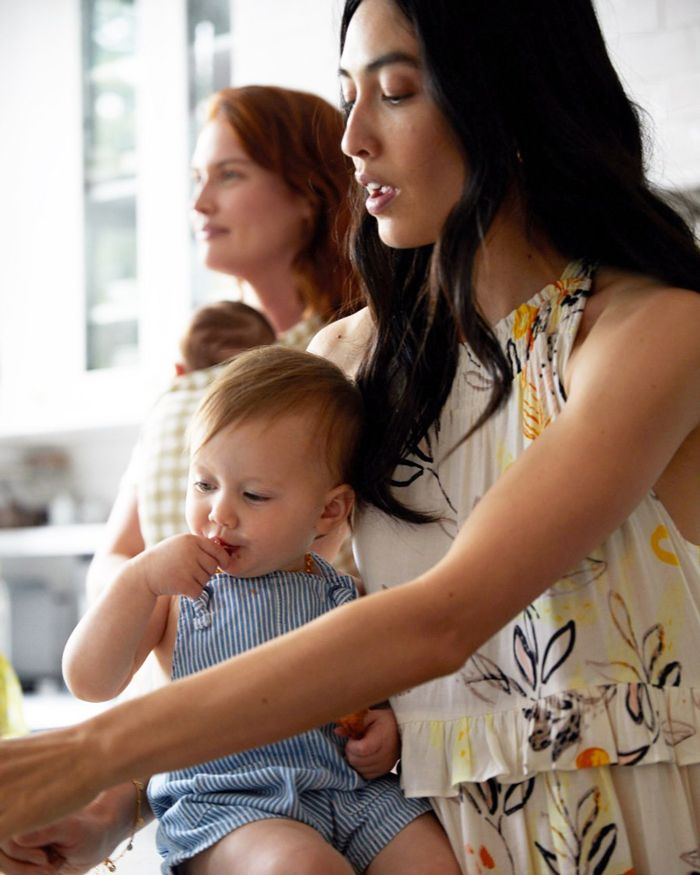 new mom with baby in rented postpartum clothes