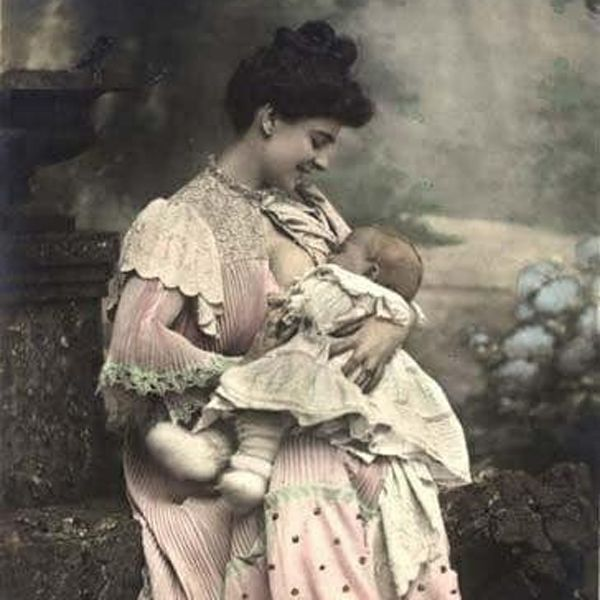 Old breastfeeding image of Victorian era mother nursing baby in a park