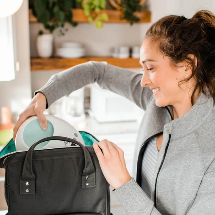 mom unpacking breast pump from bag